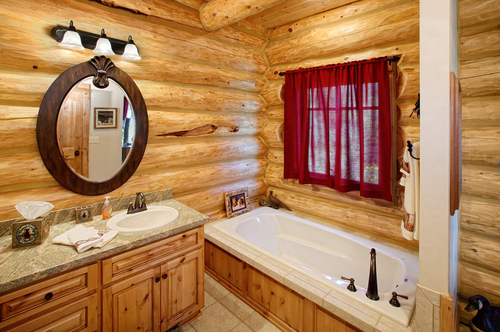 no log cabin is complete without comfortable rustic bathrooms that reflect its cozy style so whether youre building a new log cabin or updating the baths - Bathroom Ideas Log Homes