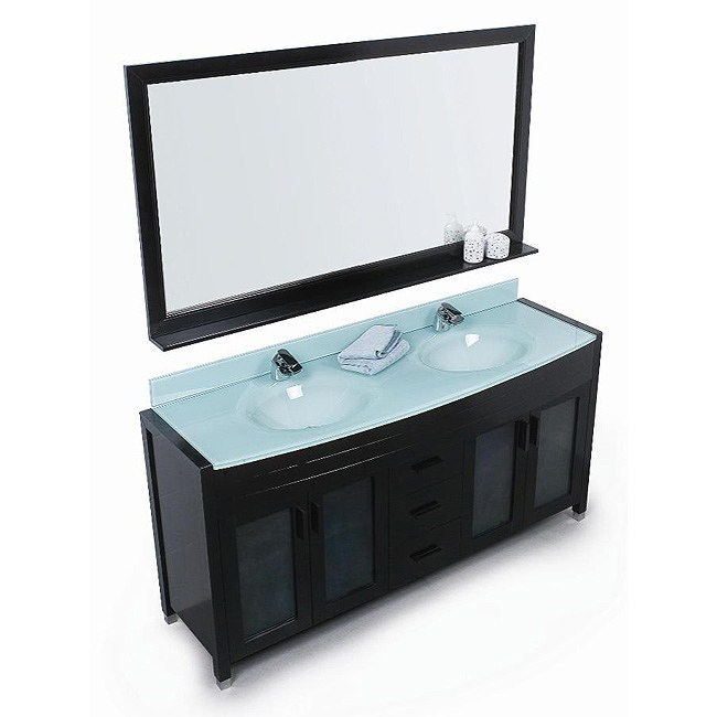 The exquisite master cabinet of the Waterfall double vanity set is made up of solid wood. One piece drop sink is included, which is made up of tempered glass top. The tempered glass is 15mm thick and is scratch proof. Three center drawers are provided to meet up with the storage functionalities. Wall mirror of 70 inches along with wall shelves are included with matching wooden frame. Cabinets are additionally provided for storage. Tempered glass back splash is included. Features Solid wood cabinetTempered glass countertopDrop in glass sink integrated with the countertopMatching pop up drainThree functional pull-out drawers with two double-door cabinetsMatching framed mirrorDetachable Wood shelf underneath the mirrorFaucet(s) not includedManufacturer provides 1 year warranty How to handle your counterSpec Sheet