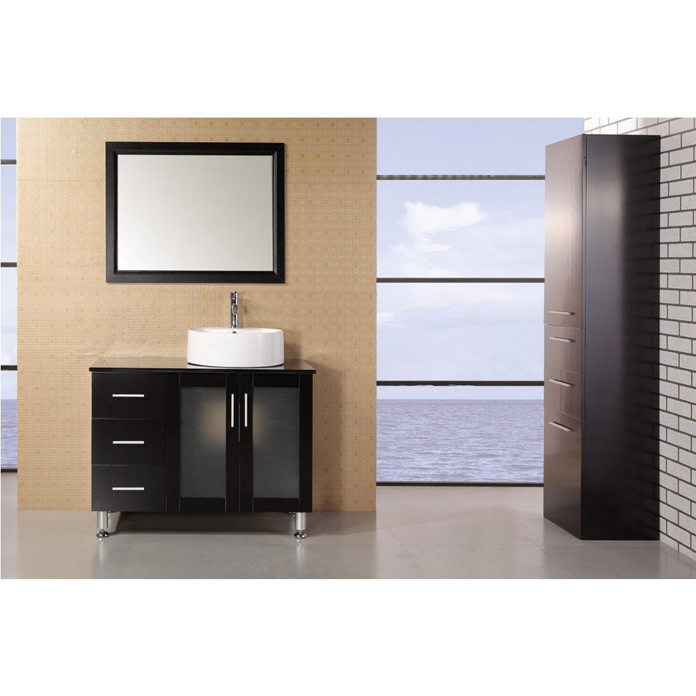 """The 39"""" Seabright showcases light, clean lines and geometric shapes though a well-balanced convergence of wood, glass, and porcelain. The result is a practical, superbly functional design with a rich range of forms, hues, and textures. The lack of architectural embellishments make the Seabright a great value and a perfect fit for the ultra-modern bathroom. Quality design points were not sacrificed, such as solid oak construction (no MDF in sight), soft-closing cabinet doors, a water-resistant finish, and a tempered glass countertop. Thanks to the round vessel sink, there's plenty of counter space, and storage space is further enhanced with three large drawers and two cabinet doors. Features: Solid Oak Wood constructionBlack Tempered Glass CountertopRound Vessel sinkPolished chrome pop up drainThree Drawers and Soft Closing Double DoorMatching framed mirrorSoft closing cabinet door ensures you never hear door slam againManufacturer provides 1 year warrantyFaucet(s) not included39""""W x 2"""