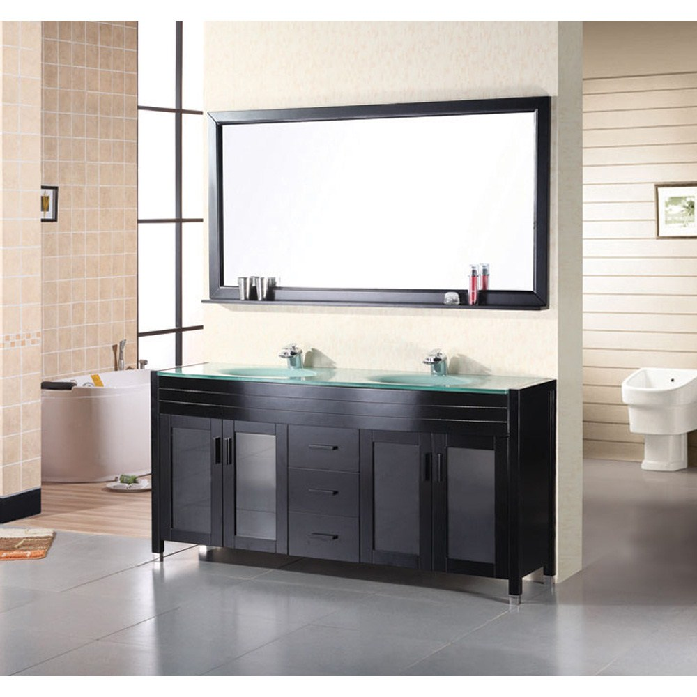 """The 70"""" Waterfall Vanity is elegantly constructed of solid oak wood. The integrated tempered glass counter top and sleek design bring contemporary elegance to any bathroom. The seamless oval drop in sink beautifully showcases the natural aqua counter top. This stylish design includes two double door cabinets and three center drawers all adorned with satin nickel hardware. Included is a large espresso framed mirror with shelf. The Waterfall Bathroom Vanity is designed as a center piece to awe-inspire the eye without sacrificing quality, functionality or durability. Features Solid oak wood cabinetEspresso finishIntegrated tempered glass counter top and sinkTwo scratch resistant drop in sinks Two chrome pop up drainsLarge espresso framed mirror with shelfTwo soft closing double door cabinets and three drawersSatin nickel finish hardwareFaucet(s) not includedManufacturer provides 1 year warranty How to handle your counterView Spec Sheet"""